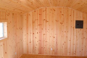Vertical knotty pine siding
