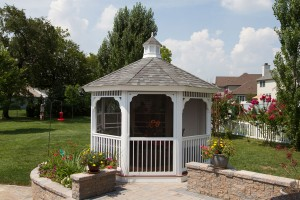 A white gazebo surrounded by grass